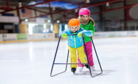 Two children learning to skate